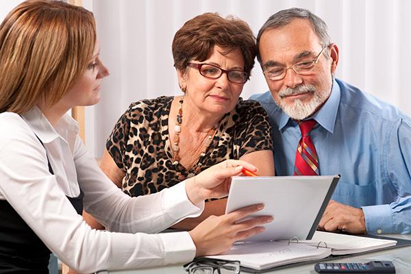 Henshalls customer service, Senior couple meeting with agent or advisor