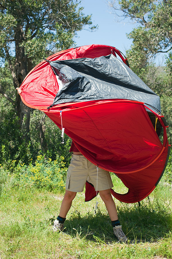Person pitching tent